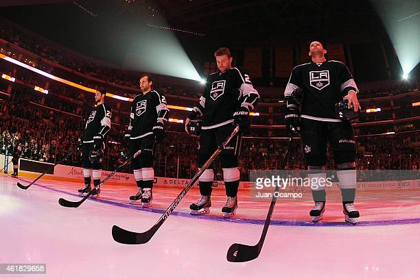 Alec Martinez Jarret Stoll Trevor Lewis and Robyn Regehr of the Los Angeles Kings stand on ice before a game against the Calgary Flames at STAPLES...