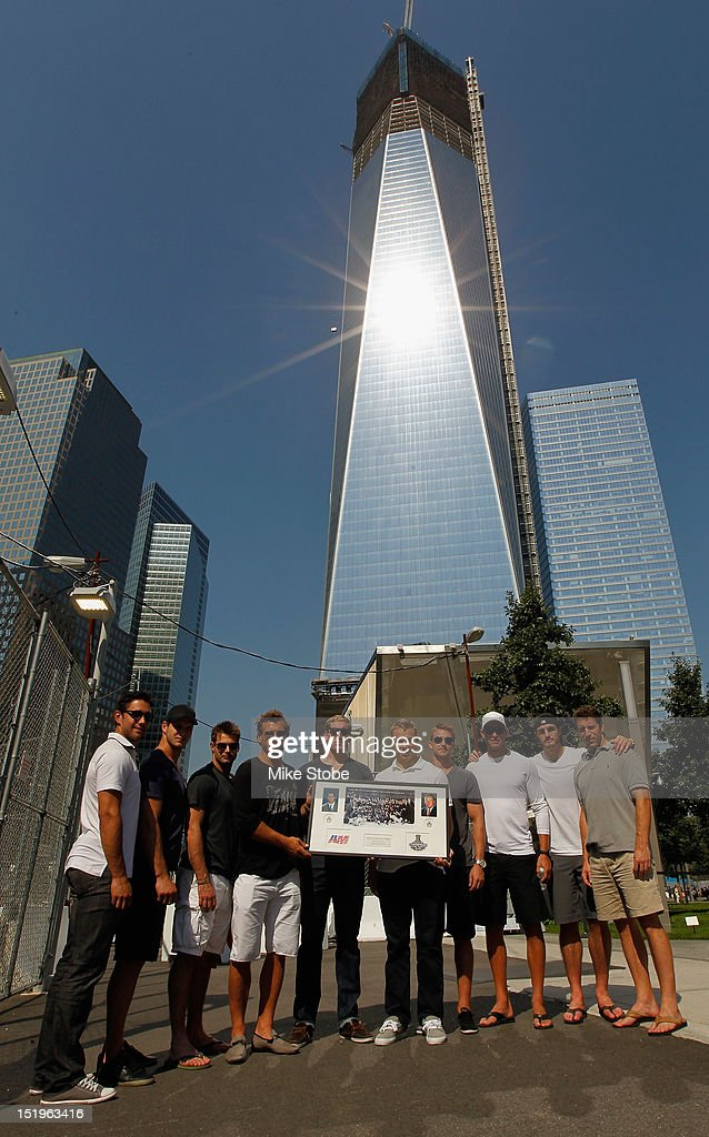 Alec Martinez, Kyle Clifford, Matt Greene, Jarret Stoll, Rob Scuderi, Dustin Brown, Trevor Lewis, Kevin Westgrath, Jeff Carter and Brad Richardson of the Los Angeles Kings pose with a plaques to pay tribute to Garnet 'Ace' Bailey, the Kings' director of pro scouting, and amateur scout Mark Bavis in lower Manhattan at the World Trade Center site on September 13, 2012 in New York City.The Los Angeles Kings felt the loss of Garnet 'Ace' Bailey, the Kings' director of pro scouting, and amateur scout Mark Bavis when hijackers took control of their scheduled Boston-to-Los Angeles flight and crashed the plane into the south tower of New York's World Trade Center.