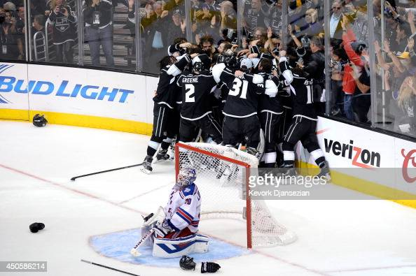 Alec Martinez of the Los Angeles Kings and the Kings celebrate after scoring the gamewinning goal in double overtime against the New York Rangers to...