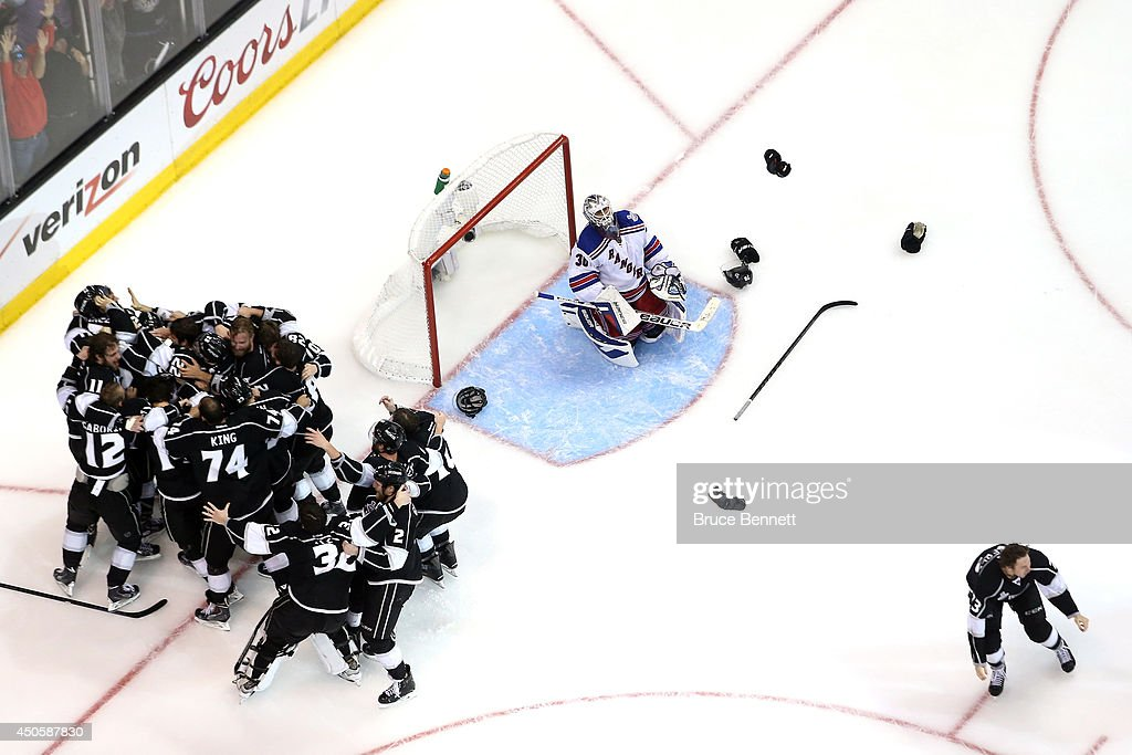 Alec Martinez #27 of the Los Angeles Kings and the Kings celebrate after scoring the game-winning goal in double overtime against goaltender Henrik Lundqvist #30 of the New York Rangers to win 3-2 in Game Five of the 2014 Stanley Cup Final at Staples Center on June 13, 2014 in Los Angeles, California.