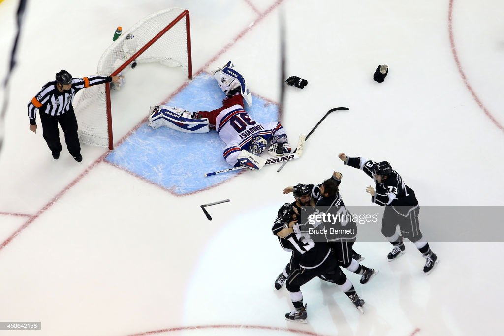 Alec Martinez #27 of the Los Angeles Kings and the Kings celebrate after Martinez scores the game-winning goal in double overtime against the New York Rangers to win 3-2 in Game Five of the 2014 Stanley Cup Final at Staples Center on June 13, 2014 in Los Angeles, California.