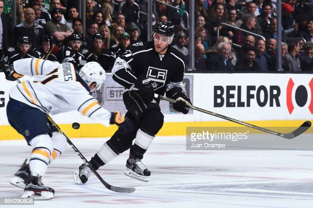 Alec Martinez of the Los Angeles Kings battles for the puck against Evan Rodrigues of the Buffalo Sabres during the game on March 16 2017 at Staples...