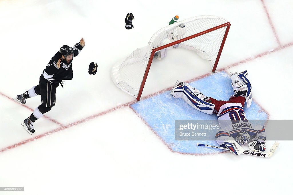 <a gi-track='captionPersonalityLinkClicked' href=/galleries/search?phrase=Alec+Martinez&family=editorial&specificpeople=5537193 ng-click='$event.stopPropagation()'>Alec Martinez</a> #27 of the Los Angeles Kings celebrates after he scores the game-winning goal in double overtime against goaltender <a gi-track='captionPersonalityLinkClicked' href=/galleries/search?phrase=Henrik+Lundqvist&family=editorial&specificpeople=217958 ng-click='$event.stopPropagation()'>Henrik Lundqvist</a> #30 of the New York Rangers to give the Kings the 3-2 victory during Game Five of the 2014 Stanley Cup Final at Staples Center on June 13, 2014 in Los Angeles, California.
