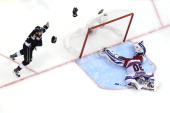 Alec Martinez of the Los Angeles Kings celebrates after he scores the gamewinning goal in double overtime against goaltender Henrik Lundqvist of the...