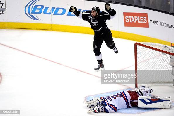 Alec Martinez of the Los Angeles Kings celebrates after scoring the gamewinning goal in double overtime against Henrik Lundqvist of the New York...