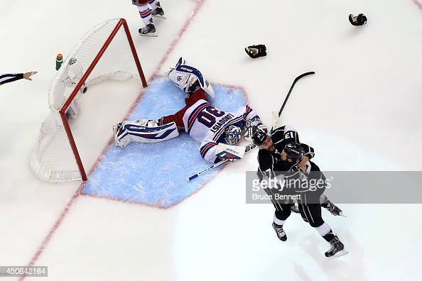 Alec Martinez of the Los Angeles Kings celebrates with Kyle Clifford after Martinez scores the gamewinning goal in double overtime against goaltender...