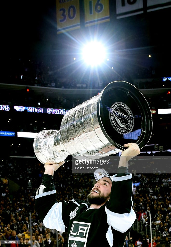 Alec Martinez of the Los Angeles Kings celebrates with the Stanley Cup after the Kings 32 double overtime victory against the New York Rangers in...