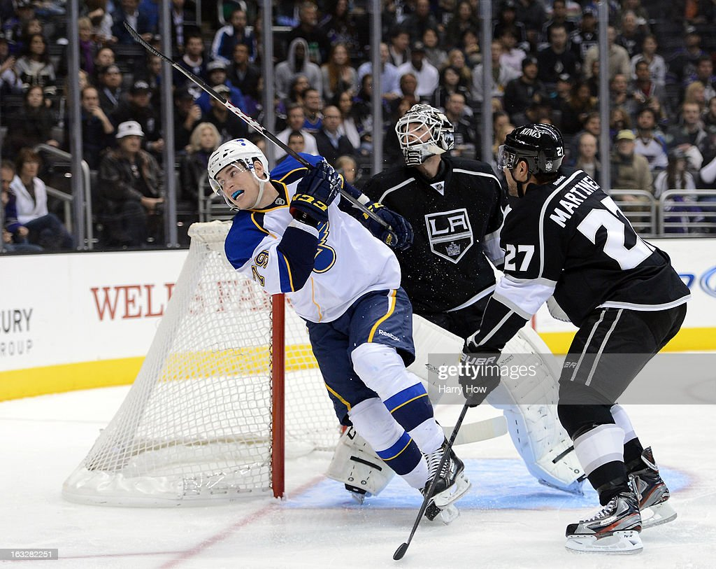 <a gi-track='captionPersonalityLinkClicked' href=/galleries/search?phrase=Alec+Martinez+-+Ice+Hockey+Player&family=editorial&specificpeople=5537193 ng-click='$event.stopPropagation()'>Alec Martinez</a> #27 of the Los Angeles Kings checks <a gi-track='captionPersonalityLinkClicked' href=/galleries/search?phrase=Adam+Cracknell&family=editorial&specificpeople=2221797 ng-click='$event.stopPropagation()'>Adam Cracknell</a> #79 of the St. Louis Blues from <a gi-track='captionPersonalityLinkClicked' href=/galleries/search?phrase=Jonathan+Bernier&family=editorial&specificpeople=540491 ng-click='$event.stopPropagation()'>Jonathan Bernier</a> #45 of the Los Angeles Kings during the first period at Staples Center on March 5, 2013 in Los Angeles, California.