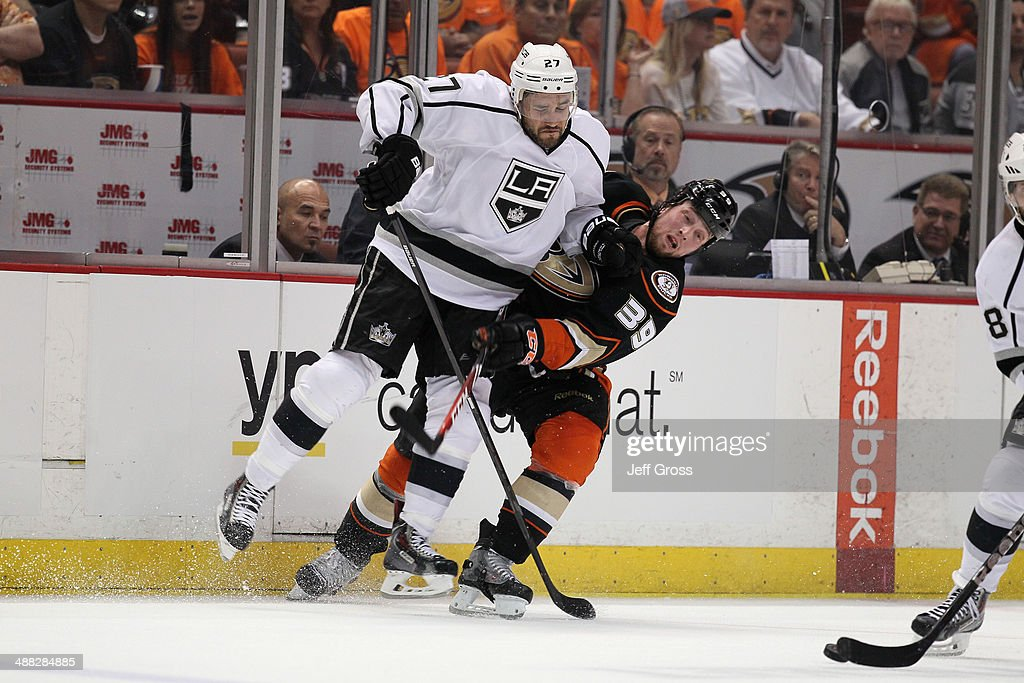 <a gi-track='captionPersonalityLinkClicked' href=/galleries/search?phrase=Alec+Martinez+-+Ice+Hockey+Player&family=editorial&specificpeople=5537193 ng-click='$event.stopPropagation()'>Alec Martinez</a> #27 of the Los Angeles Kings checks <a gi-track='captionPersonalityLinkClicked' href=/galleries/search?phrase=Matt+Beleskey&family=editorial&specificpeople=570471 ng-click='$event.stopPropagation()'>Matt Beleskey</a> #39 of the Anaheim Ducks in the third period of Game One of the Second Round of the 2014 NHL Stanley Cup Playoffs at Honda Center on May 3, 2014 in Anaheim, California.