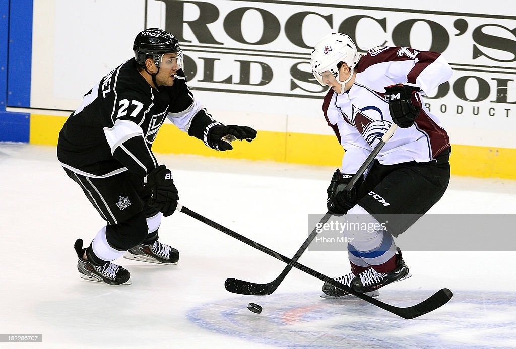 <a gi-track='captionPersonalityLinkClicked' href=/galleries/search?phrase=Alec+Martinez&family=editorial&specificpeople=5537193 ng-click='$event.stopPropagation()'>Alec Martinez</a> #27 of the Los Angeles Kings defends against <a gi-track='captionPersonalityLinkClicked' href=/galleries/search?phrase=Nathan+MacKinnon&family=editorial&specificpeople=8610127 ng-click='$event.stopPropagation()'>Nathan MacKinnon</a> #29 of the Colorado Avalanche during their preseason game at the MGM Grand Garden Arena on September 28, 2013 in Las Vegas, Nevada. Colorado won 3-2.