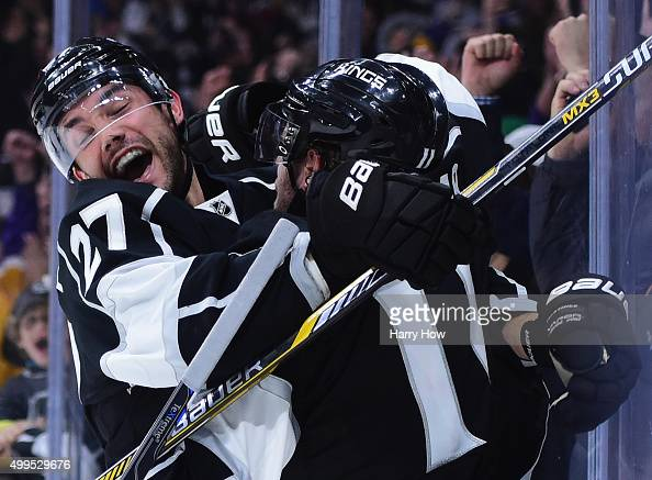 Alec Martinez of the Los Angeles Kings hugs Anze Kopitar in celebration of his overtime goal to beat the Vancouver Canucks 21 in overtime at Staples...