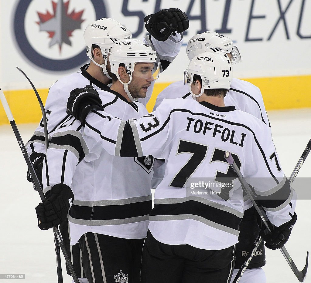 <a gi-track='captionPersonalityLinkClicked' href=/galleries/search?phrase=Alec+Martinez&family=editorial&specificpeople=5537193 ng-click='$event.stopPropagation()'>Alec Martinez</a> #27 of the Los Angeles Kings is congratulated on his goal in third-period action in an NHL game against the Winnipeg Jets at the MTS Centre on March 6, 2014 in Winnipeg, Manitoba, Canada.