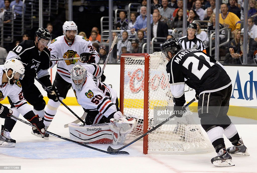 Alec Martinez #27 of the Los Angeles Kings misses a chance against goaltender Corey Crawford #50 of the Chicago Blackhawks in the second period in Game Six of the Western Conference Final during the 2014 Stanley Cup Playoffs at Staples Center on May 30, 2014 in Los Angeles, California.