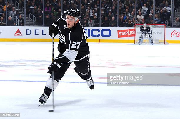 Alec Martinez of the Los Angeles Kings passes the puck during a game against the San Jose Sharks at STAPLES Center on December 22 2015 in Los Angeles...
