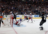 Alec Martinez of the Los Angeles Kings scores the gamewinning double overtime goal against goaltender Henrik Lundqvist of the New York Rangers to win...