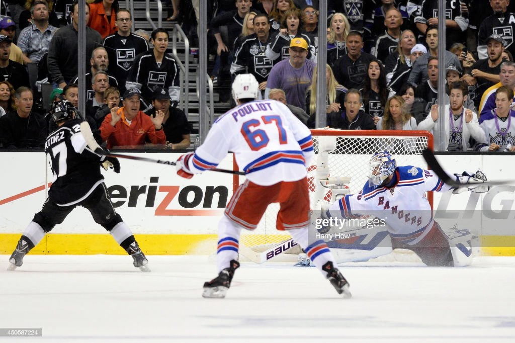Alec Martinez #27 of the Los Angeles Kings scores the game-winning goal in double overtime to give the Kings a 3-2 victory during Game Five of the 2014 Stanley Cup Final at Staples Center on June 13, 2014 in Los Angeles, California.