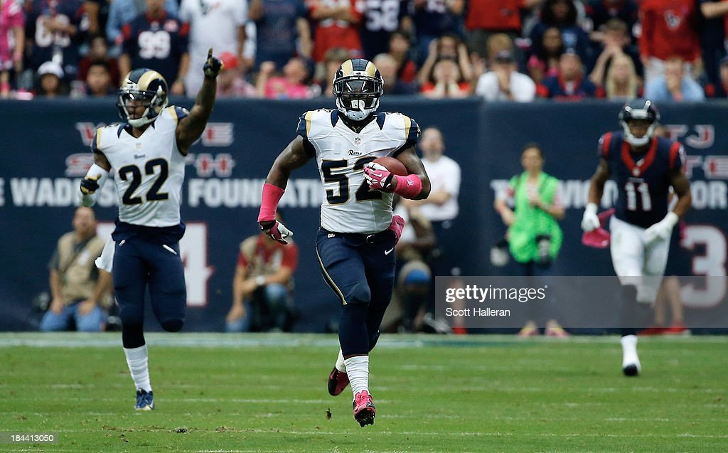 <a gi-track='captionPersonalityLinkClicked' href=/galleries/search?phrase=Alec+Ogletree&family=editorial&specificpeople=7303236 ng-click='$event.stopPropagation()'>Alec Ogletree</a> #52 of the St. Louis Rams returns an interception 98 yards for a touchdown in the third quarter against the Houston Texans at Reliant Stadium on October 13, 2013 in Houston, Texas.