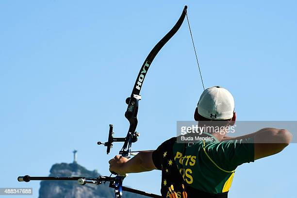 Alec Potts of Australia prepares to shoot during the first day of the Archery test event for the Rio 2016 Olympic Games at Sapucai Sambodrome on...
