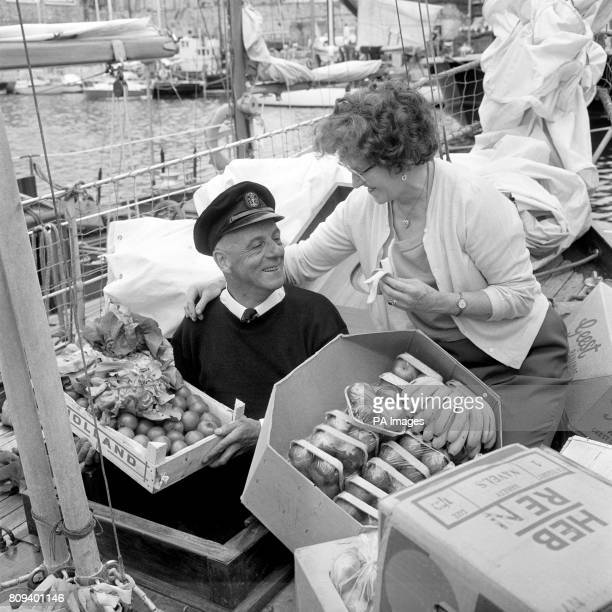Alec Rose who is a fruit and vegetable merchant takes supplies of both on board as helped by his wife Dorothy he provisions the nineton cutter Lively...