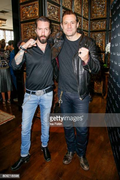 Alec Voelkel and Sascha Vollmer of the band The BossHoss attend the Thomas Sabo Press Cocktail during the MercedesBenz Fashion Week Berlin...