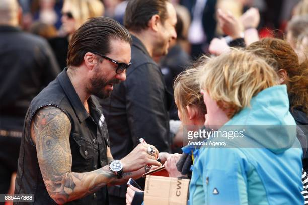 Alec Voelkel or Boss Burns singer of the German band named the Boss Hoss autographs for his fans during the ECHO German Music Award in Berlin Germany...