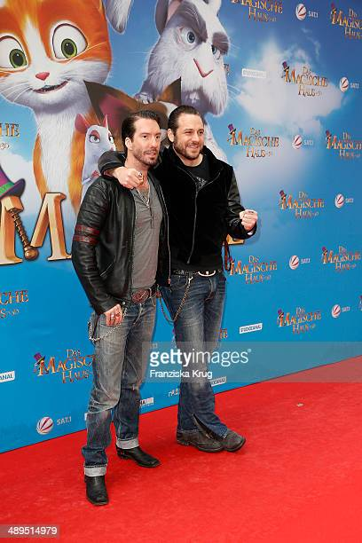Alec Voelkel Sascha Vollmer from 'The BossHoss' attend the 'Das magische Haus' Berlin Premiere at Cinemaxx on May 11 2014 in Berlin Germany