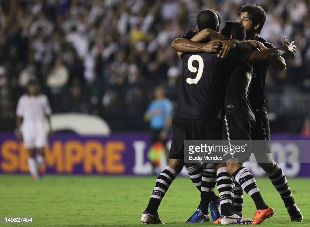 Alecsandro Eder Luis and Juninho of Vasco celebrate a scored goal aganist Nautico during a match as part of Serie A 2012 at Sao Januario stadium on...