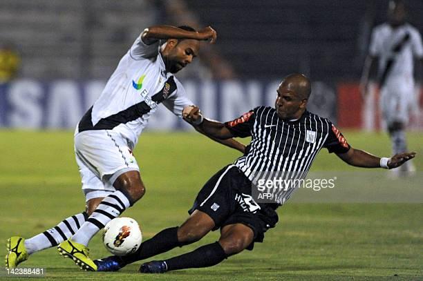 Alecsandro Felisbino from Brazilian Vasco Da Gama vies for the ball with Peruvian Alianza Lima's Edgar Gonzalez during their 2012 Libertadores Cup...