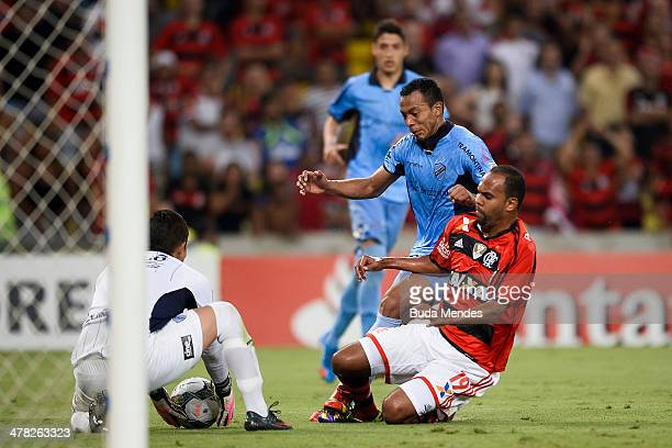 Alecsandro of Flamengo battles for the ball against Edemir Rodriguez of Bolivar during a match between Flamengo and Bolivar as part of Copa...