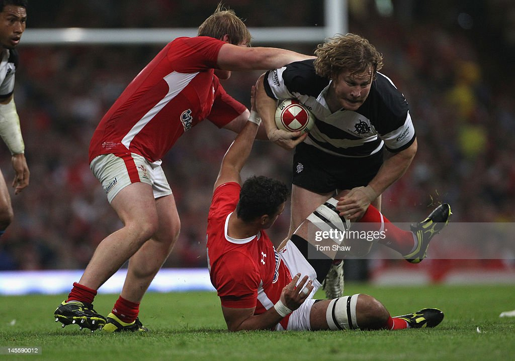 Aled De Malmanche of the Barbarians is tackled by Aaron Shingler of Wales during the international match between Wales and The Barbarians at Millennium Stadium on June 2, 2012 in Cardiff, Wales.