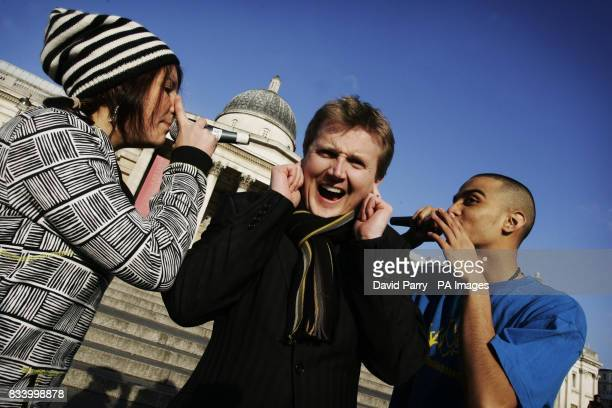 Aled Jones centre and from left Bella Trix and MC Zani from London's Beatbox Orchestra perform their remixed version of Silent Night on Trafalgar...