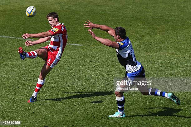 Aled Thomas of Gloucester kicks clear as Sam Burgess of Bath challenges during the Aviva Premiership match between Bath Rugby and Gloucester Rugby at...
