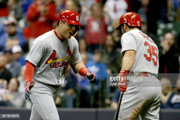 Aledmys Diaz and Greg Garcia of the St Louis Cardinals celebrate after Diaz hit a home run in the seventh inning against the Milwaukee Brewers at...