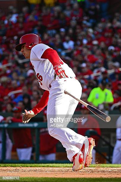 Aledmys Diaz of the St Louis Cardinals bats against the Milwaukee Brewers during the home opener at Busch Stadium on April 11 2016 in St Louis...