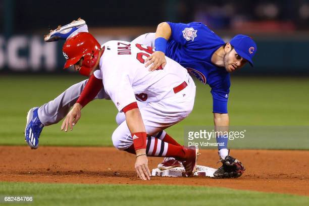 Aledmys Diaz of the St Louis Cardinals breaks up a double play against Tommy La Stella of the Chicago Cubs in the fourth inning at Busch Stadium on...