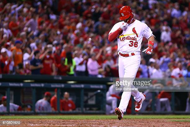 Aledmys Diaz of the St Louis Cardinals crosses home plate on his grand slam against the Cincinnati Reds in the fourth inning at Busch Stadium on...