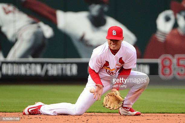 Aledmys Diaz of the St Louis Cardinals fields a ground ball against the Milwaukee Brewers during the home opener at Busch Stadium on April 11 2016 in...