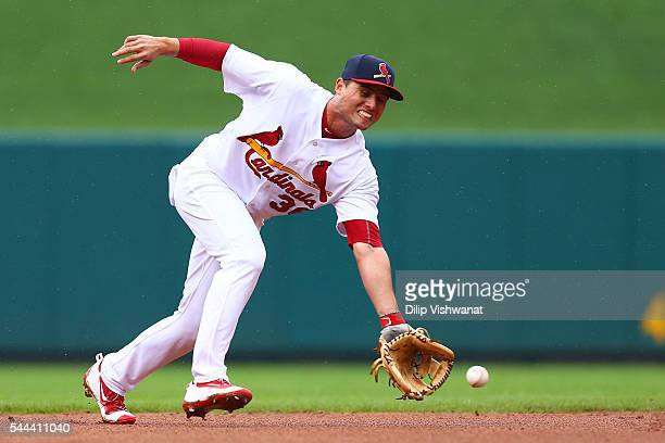 Aledmys Diaz of the St Louis Cardinals fields a ground ball against the Milwaukee Brewers in the fourth inning at Busch Stadium on July 3 2016 in St...