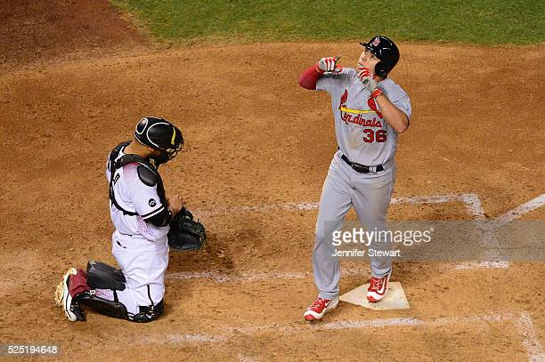 Aledmys Diaz of the St Louis Cardinals gestures after hitting a solo home run in the fifth inning against the Arizona Diamondbacks at Chase Field on...