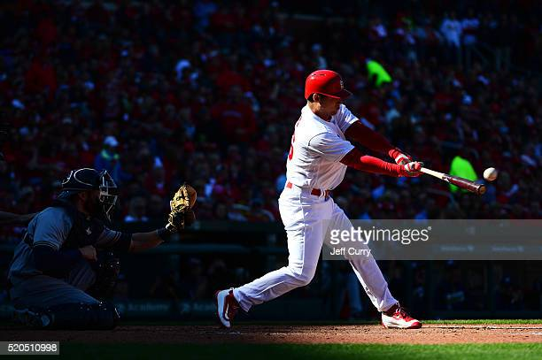 Aledmys Diaz of the St Louis Cardinals hits a one run double in the third inning against the Milwaukee Brewers during the home opener at Busch...