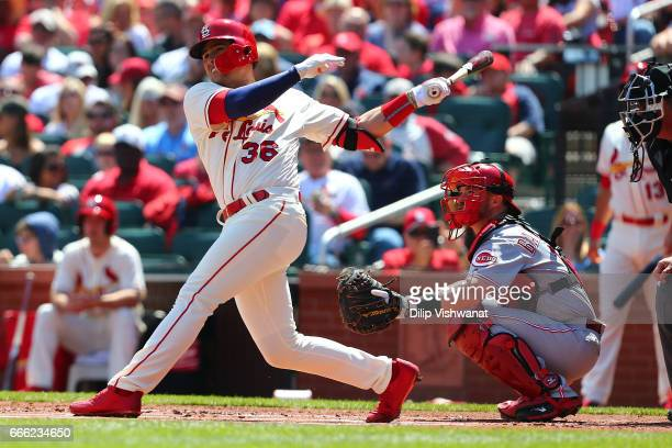 Aledmys Diaz of the St Louis Cardinals hits a solo home run against the Cincinnati Reds in the first inning at Busch Stadium on April 8 2017 in St...