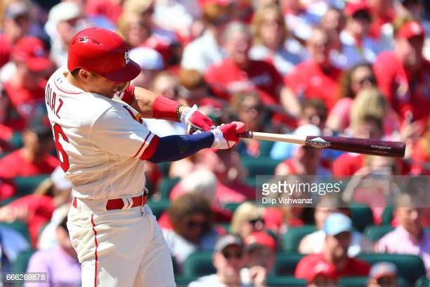 Aledmys Diaz of the St Louis Cardinals hits a threerun home run against the Cincinnati Reds in the fourth inning at Busch Stadium on April 8 2017 in...