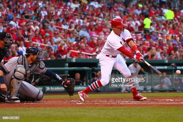 Aledmys Diaz of the St Louis Cardinals hits an RBI single against the Milwaukee Brewers in the first inning at Busch Stadium on June 15 2017 in St...