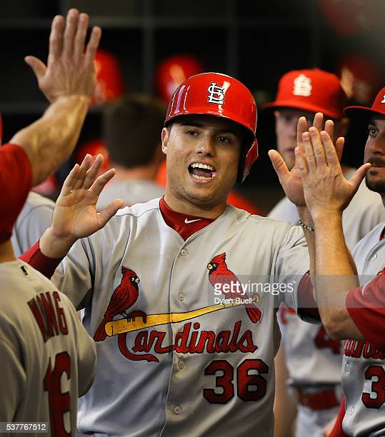 Aledmys Diaz of the St Louis Cardinals is congratulated by teammates after scoring a run against the Milwaukee Brewers at Miller Park on May 31 2016...
