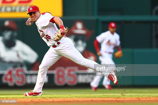 Aledmys Diaz of the St Louis Cardinals looks to throw a runner out against the Miami Marlins in the first inning at Busch Stadium on July 15 2016 in...