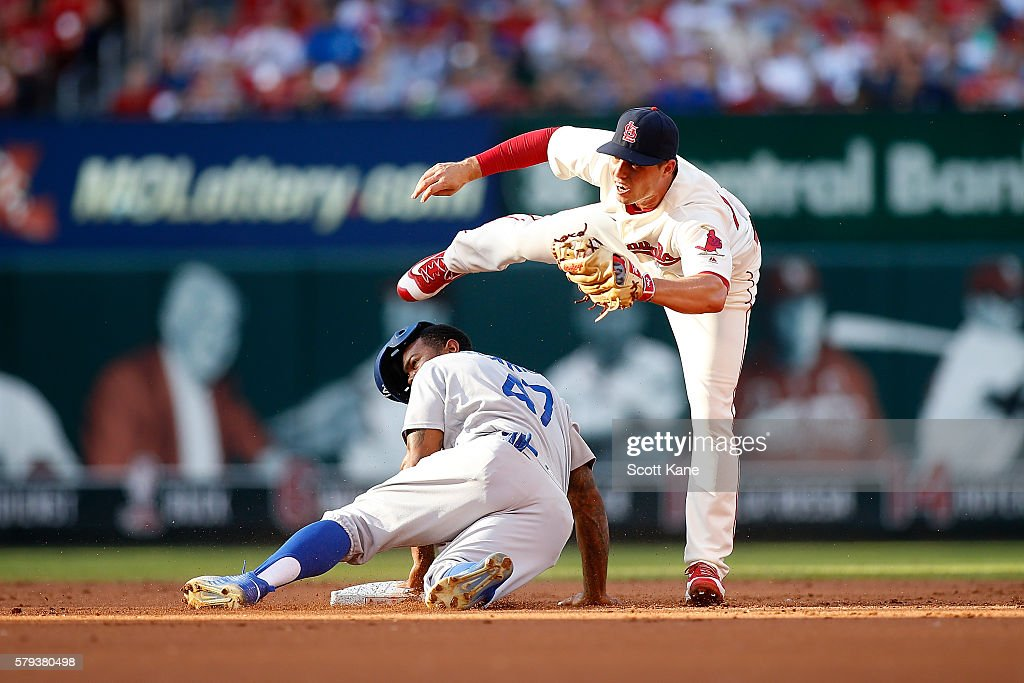 Aledmys Diaz #36 of the St. Louis Cardinals makes an out against Howie Kendrick #47 of the Los Angeles Dodgers as he attempts to steal second base during the second inning of a baseball game at Busch Stadium on July 23, 2016 in St. Louis, Missouri.
