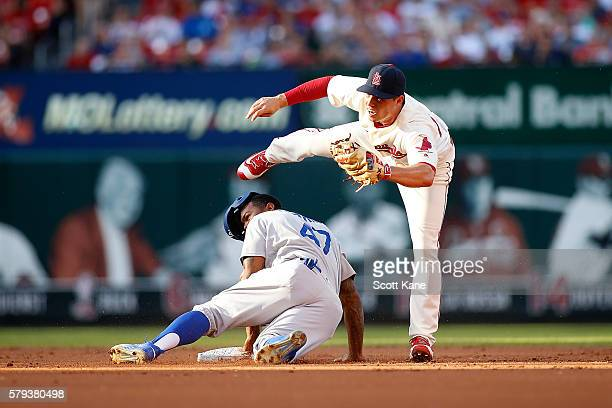 Aledmys Diaz of the St Louis Cardinals makes an out against Howie Kendrick of the Los Angeles Dodgers as he attempts to steal second base during the...