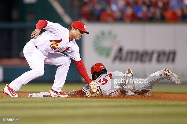 Aledmys Diaz of the St Louis Cardinals puts the tag on Odubel Herrera of the Philadelphia Phillies as he attempts to steal second base during the...