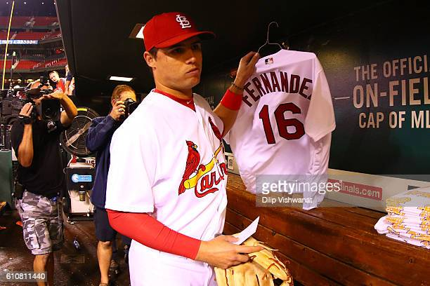 Aledmys Diaz of the St Louis Cardinals removes a memorial for Miami Marlins pitcher Jose Fernandez after defeating the Cincinnati Reds at Busch...