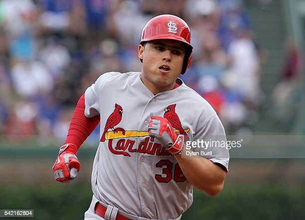Aledmys Diaz of the St Louis Cardinals rounds the bases after hitting a home run in the sixth inning against the Chicago Cubs at Wrigley Field on...